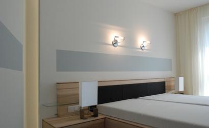 Schlafzimmer einer ferienwohnung innenarchitekt in for Was ist ein innenarchitekt